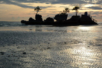 Willy's rock silhouette with low tide. White Beach. Boracay island. Western Visayas. Philippines