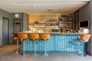 Blue bar counter with chairs in a cafe bar interior