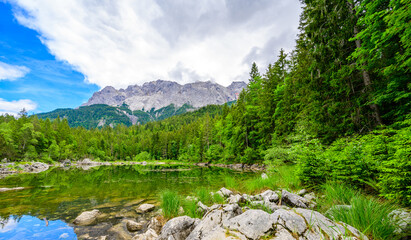 Frillensee Lake with Zugspitze mountain. Beautiful landscape scenery at Eibsee Lake in German Alps, Bavaria, Germany, Europe.