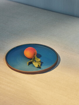 Close up of peach on plate