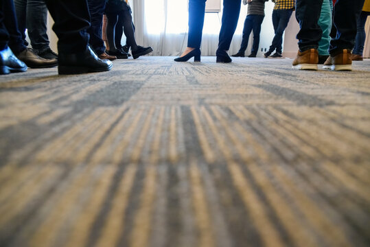 Low Section Of People On Carpet