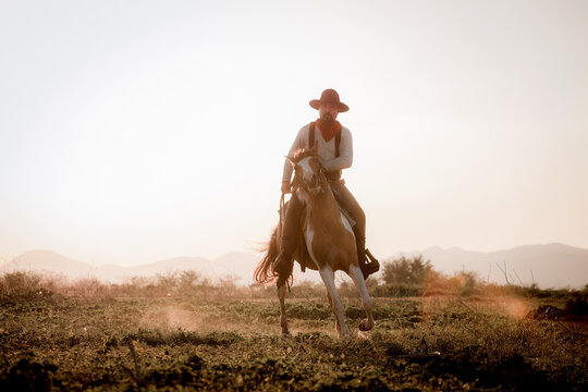 Full Length Of Man Horseback Riding Against Sky