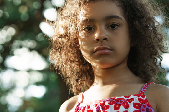 Portrait of serious black girl in a park