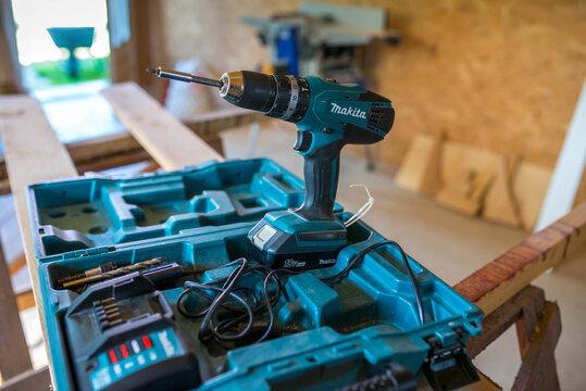 Miercurea Ciuc , Romania- 05 August 2020: Makita screwdriver on plastic case in a small workshop.