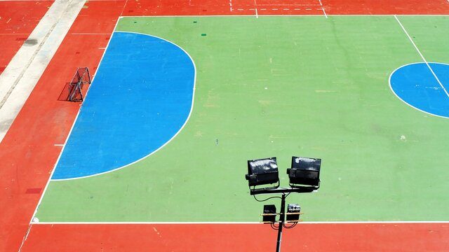 High Angle View Of Basketball Hoop Against Blue Wall