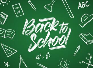 Vector Handwritten typographic lettering of Back to School with doodles supplies on blackboard background