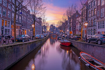 City scenic from Amsterdam at the Oude Zijdsvoorburgwal in the Netherlands at sunset