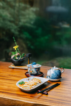 Food series: Gyoza (pot sticker) on wooden table in ryokan, traditional Japanese hotel