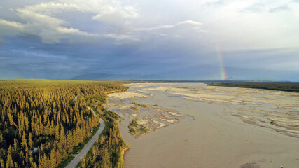 Wall Mural - The Delta River makes it's way south from Fairbanks Alaska as a Rainbow Appears