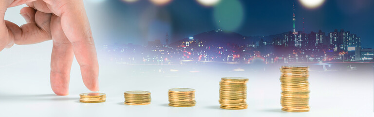web banner business and finance investment and saving activity with gold coin arrange and finger acting with soft focus night city background
