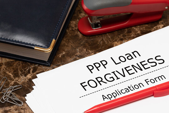 PPP loan forgiveness text on application form paper. Small Business Payroll Protection Program.