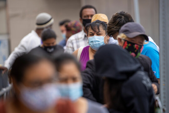 Customers wait in line to shop for food at a Food 4 Less grocery store, during the outbreak of the coronavirus disease (COVID-19), in Los Angeles