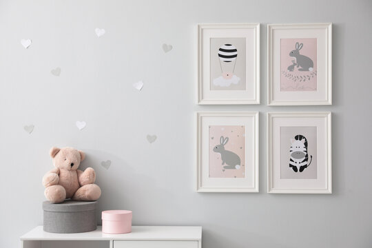 Stylish baby room interior with cute pictures on wall
