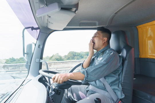 Professional adult truck driver is tired, transport, and deliver for a long time.