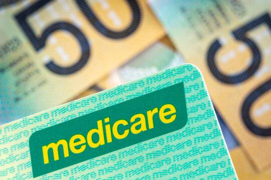 Australian Medicare Card over Blurred Money Background