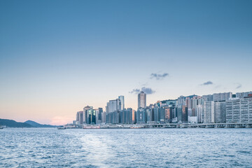 East side cityscape of Victoria Harbour, Hong Kong, evening