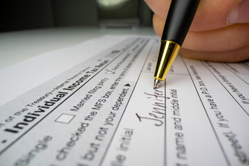 Close-up view of completing US tax form