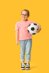Cute little girl with soccer ball on color background