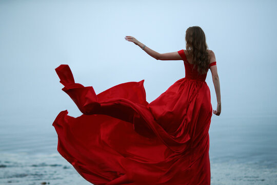 woman in a long red dress. Back view