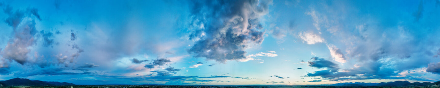 Drone viewpoint of sunset sky in summer season. Panoramic view of dusk clouds