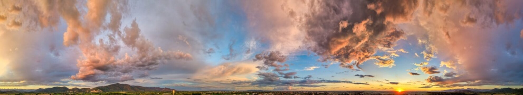 Amazing panoramic aerial view of sunset sky. Beautiful clouds and colors at dusk