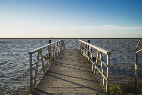 Mesmerizing view of a pier leading to Guadalquivir river in Trebujena, Cadiz, Spain
