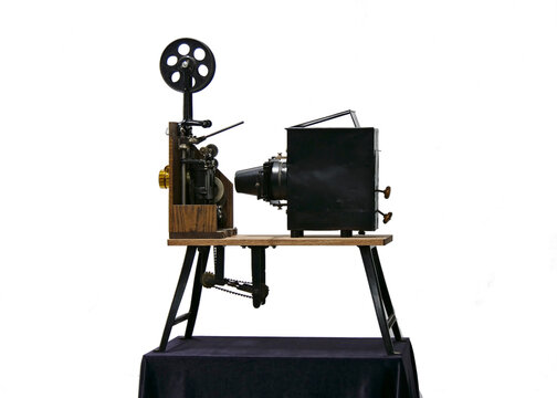 Antique film projector with wooden body, late 19th century