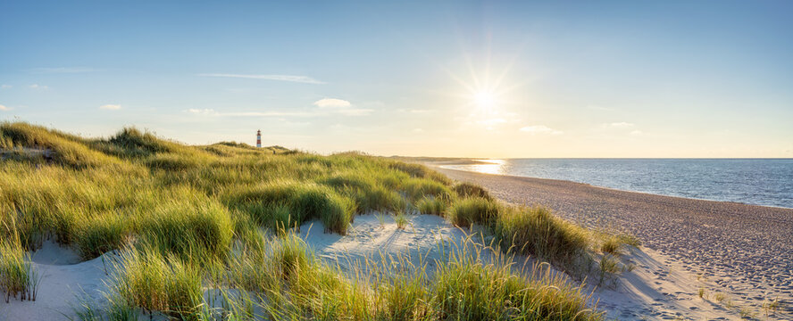 Dune beach with lighthouse on the island of Sylt, Schleswig-Holstein, Germany