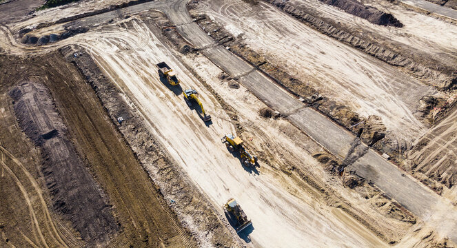 On the outskirts of Melbourne Australia, a new estate is in the early stages of construction, heavy machinery terraforms the hillside, roads are being built and drainage installed before houses arrive