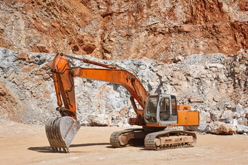 Heavy excavator on a quarry. Excavation machinery. Earthmover work
