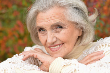 Close-up portrait of happy senior woman posing