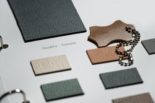 leather swatch book with various different colors.