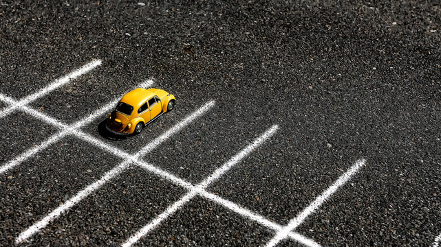 Minsk, Belarus-August 2020: a yellow car stands in an empty parking lot with markings for social distance in coronavirus covid19, quarantine, lockdown, empty cities, eco