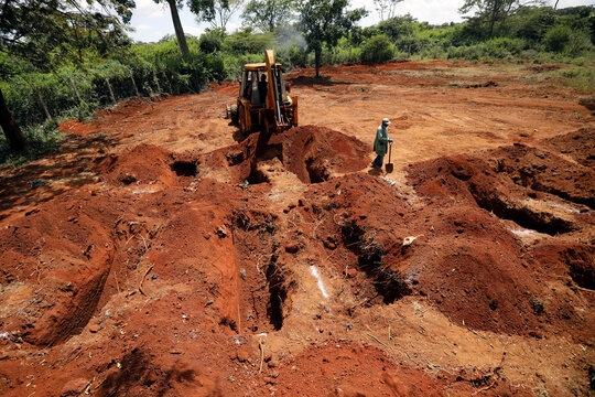 An excavator is seen digging new graves at the separated section of the muslim cemetery, amid the coronavirus disease (COVID-19) outbreak, in Nairobi