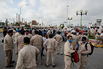 Workers of the Mexican state oil firm PEMEX protest against Senator Samuel Garcia's proposal to close down the Cadereyta refinery as a measure to lower the levels of pollution in the air, in Cadereyta