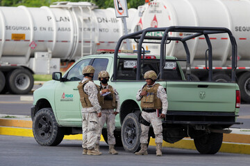 Soldiers are seen during a protest against Senator Samuel Garcia's proposal to close down the Mexican state oil firm Pemex's Cadereyta refinery as a measure to lower the levels of pollution in the air, in Cadereyta