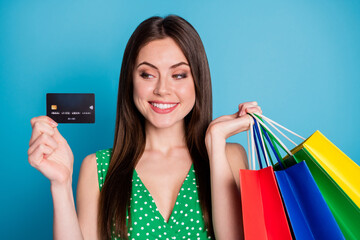 Close up photo of positive cheerful girl hold look credit bank card pay many bags wear style...