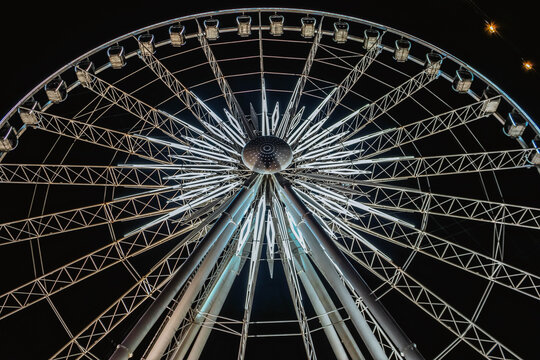 Huge observation wheel at night. View from above.