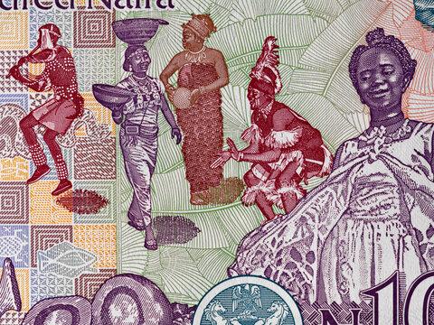 Traditional african dancers on Nigeria 100 naira banknote close up macro, Nigerian money closeup