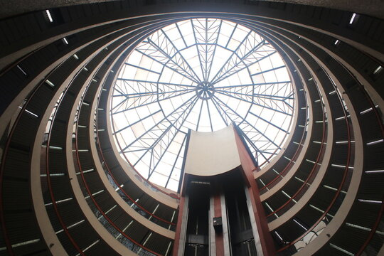 Inside of a circular shopping mall showing the many different levels which can be walked to the top and the windows
