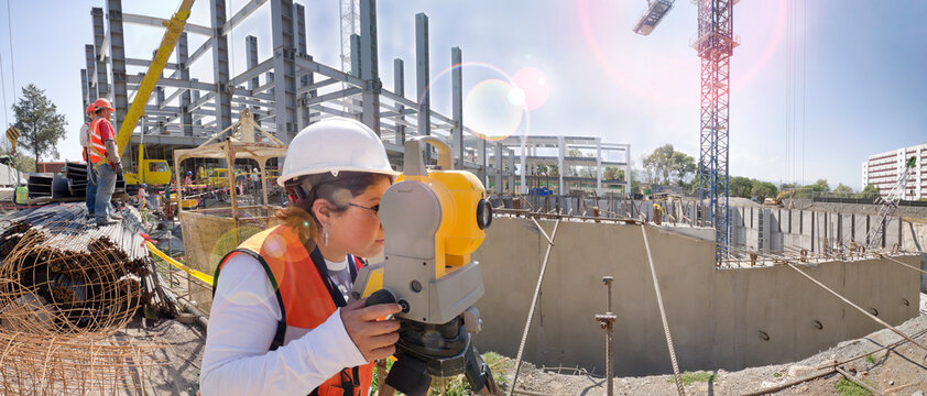 Topographical survey engineer in a building project Panoramic view of a huge construction site