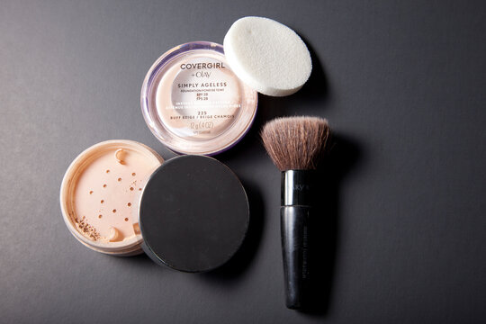 Cover Girl makeup and Mary Kay powder and brush