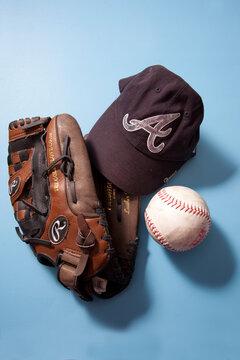 Atlanta Braves MLB ball cap and SPN softball and Rawlings glove