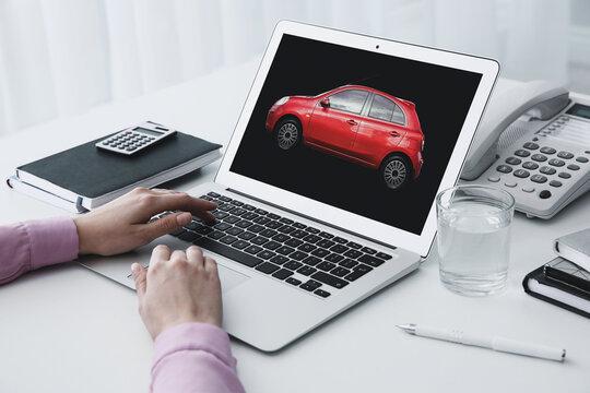 Buying online. Woman choosing car using laptop, closeup view