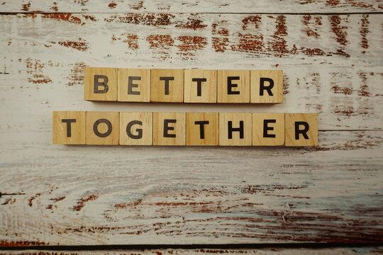 Better Together alphabet letter on wooden background