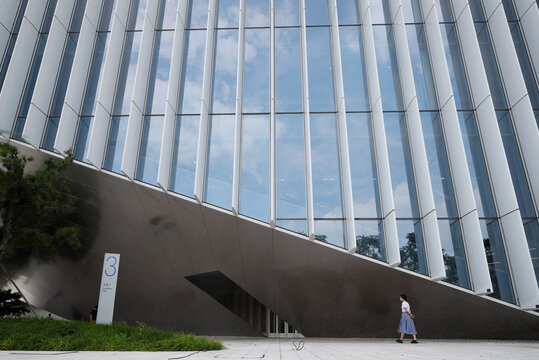 A woman walks past an office building of Chinese tech firm Tencent, owner of messaging app WeChat, in Beijing