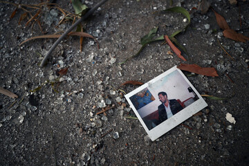 A photograph is seen amongst broken glass on the roof of a residential building that was damaged in Tuesday's blast in Beirut's port area