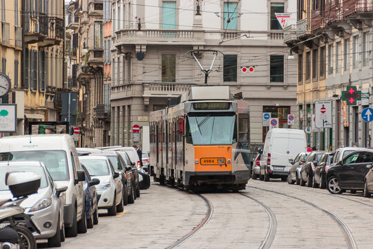 Trip tram goes along Cusani street in Milan, Italy.