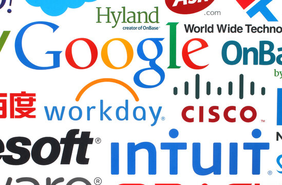 KIEV, UKRAINE - MAY 12, 2015:Collection of popular internet companies printed on paper:Google, Workday, Microsoft, Intuit and others on white background