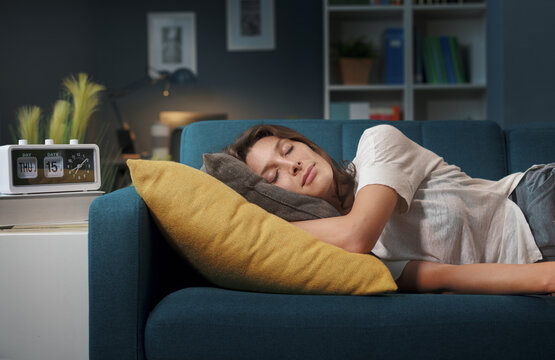 Relaxed woman sleeping on the sofa at home